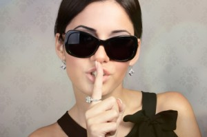 Woman with dark glasses being secretive and private