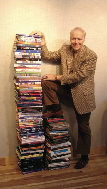 David E. carter with his 114 Books