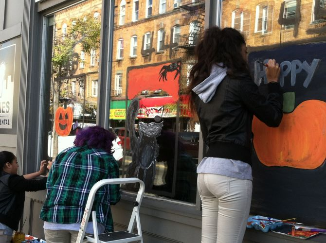 Students-painting-jersey-city-business-windows-for-halloween
